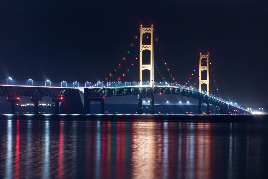 The Mackinac Bridge connects the lower and upper peninsulas of Michigan, shining bright at night!