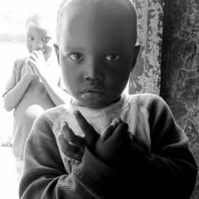 While volunteering in Kenya during the summer of 2013, I was visiting with a local family and this young child came in to visit. The eyes get me ...