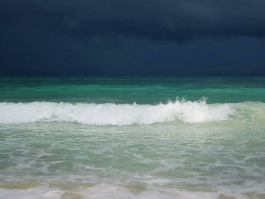 While volunteering in Kenya, I had the chance to visit the beach. That day a storm was rolling in...