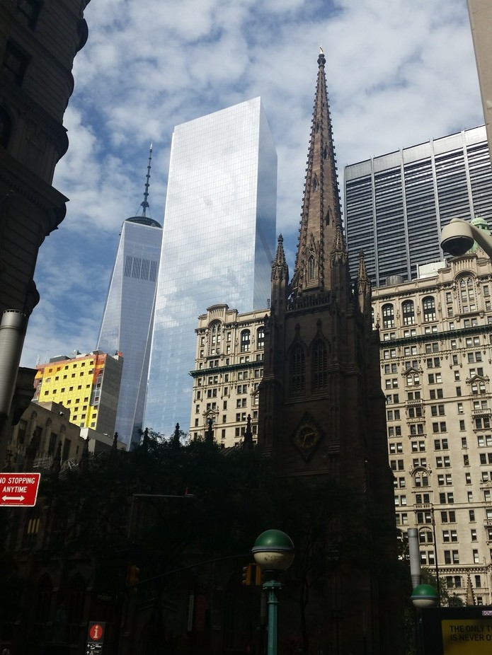 World Trade and Trinity Church as seen from Wall St