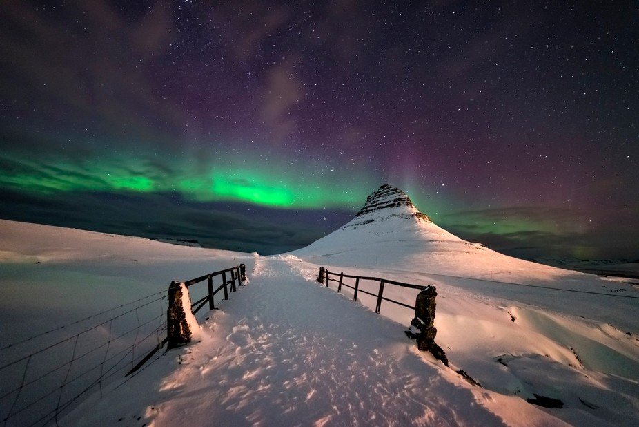 Different view to famous Kirkjufell mountain in Iceland. Great aurora display on this night, kept...