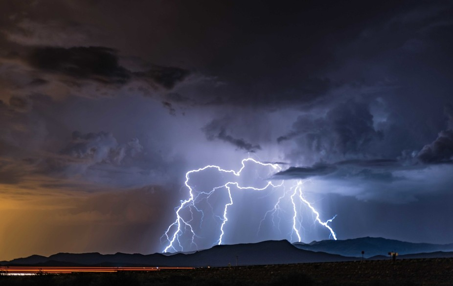 Chasing the August lightning in Tuscon Arizona.  Freeway lights in the foreground.  Nature puttin...