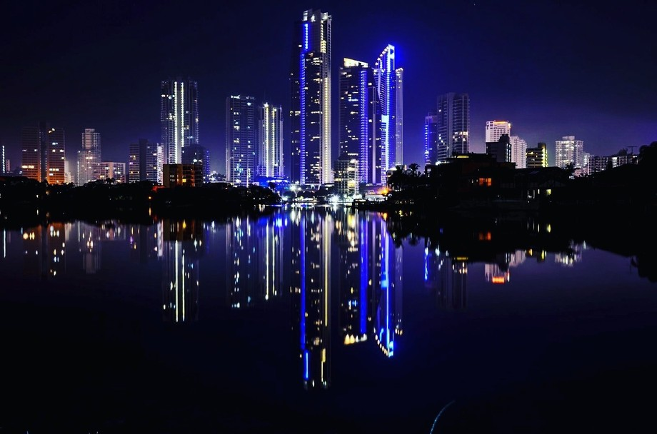 Surfers paradise lit up at night and reflected on the chevron island waters
