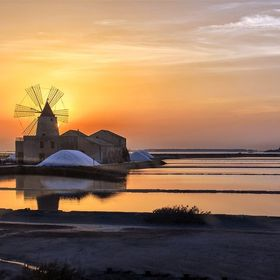 Salt sunset at Marsala. Marsala is a sicilian town famous from  the end of the 18th century for Marsala wine, vinegars, for the salt pans which p...