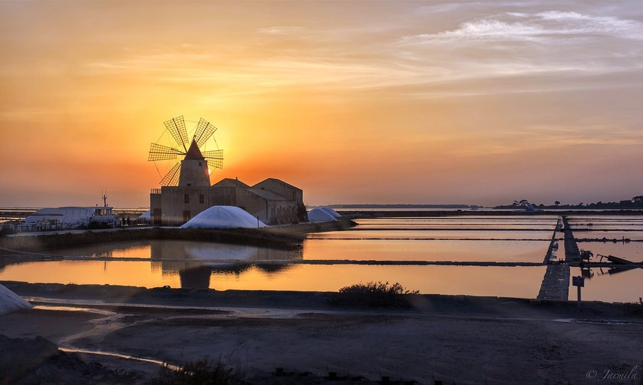 Salt sunset at Marsala. Marsala is a sicilian town famous from  the end of the 18th century for M...