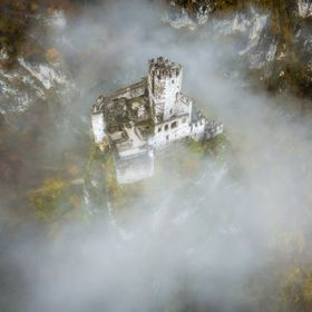 The Haderburg is a castle in the Town Salurn in South Tyrol, situated on the top of a rock the fog surrounds this old medieval Castle.