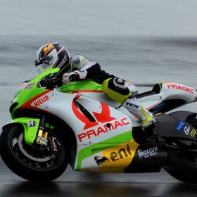one from 2011 motogp silverstone. wet and cold! Hand held,  difficult to pan and snap in the cold but i managed