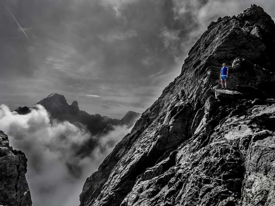 Taken on the Crochues Traverse In Chamonix,  France. The runner takes a brief pause In sun before...