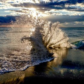 This was captured at Oceanridge Florida during a spectacular sunrise as the waves splashed by the jetty.