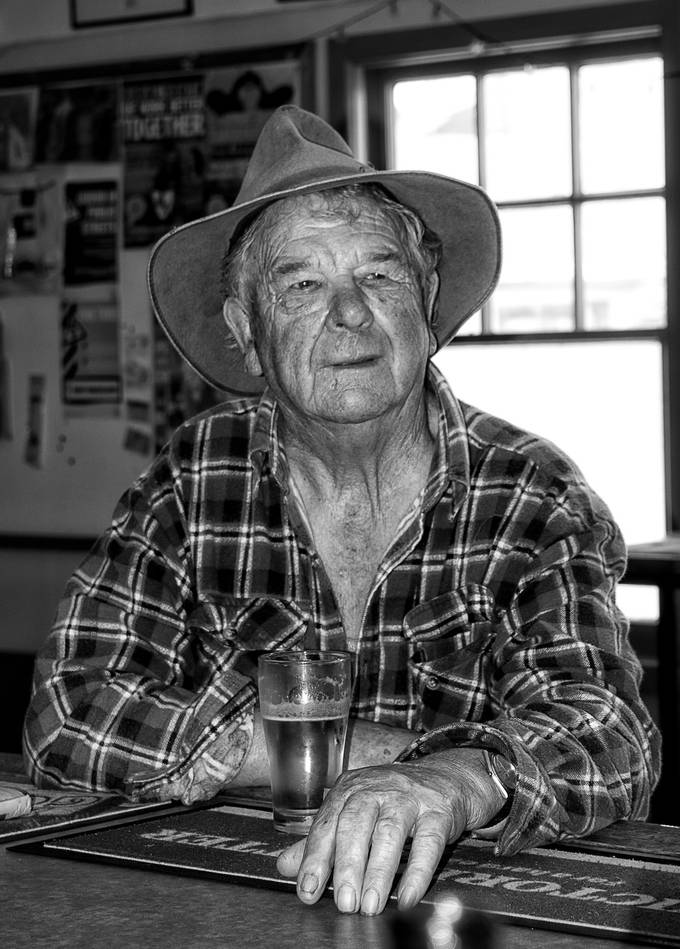 Sharing a cold beer and a story or two with one of the locals at the Ouse Pub, Tasmania.