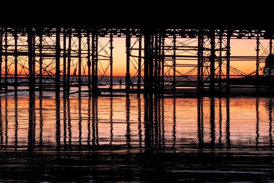 the sunsetting behind hastings pier