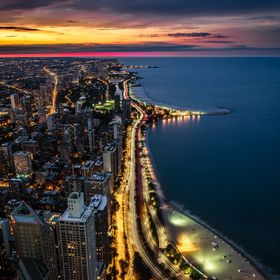 Colorful sunset over the Gold Coast - View from 360 Chicago at the John Hancock Center in Chicago, IL.