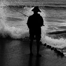 This was taken in Oceanridge FL as a fisherman stood by the jetty, waves crashing around him, creating a perfect aura around him