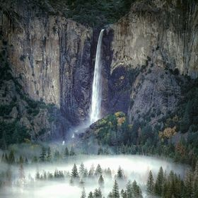 Bridalveil Fall in Yosemite plunging into a sea of fog in the valley below.