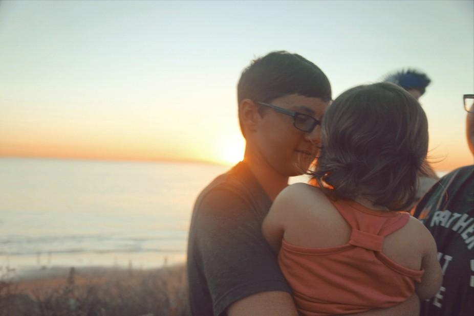 My son smiling at his cousin while the sunsets behind them at Crystal Cove Beach Laguna Beach, Ca.