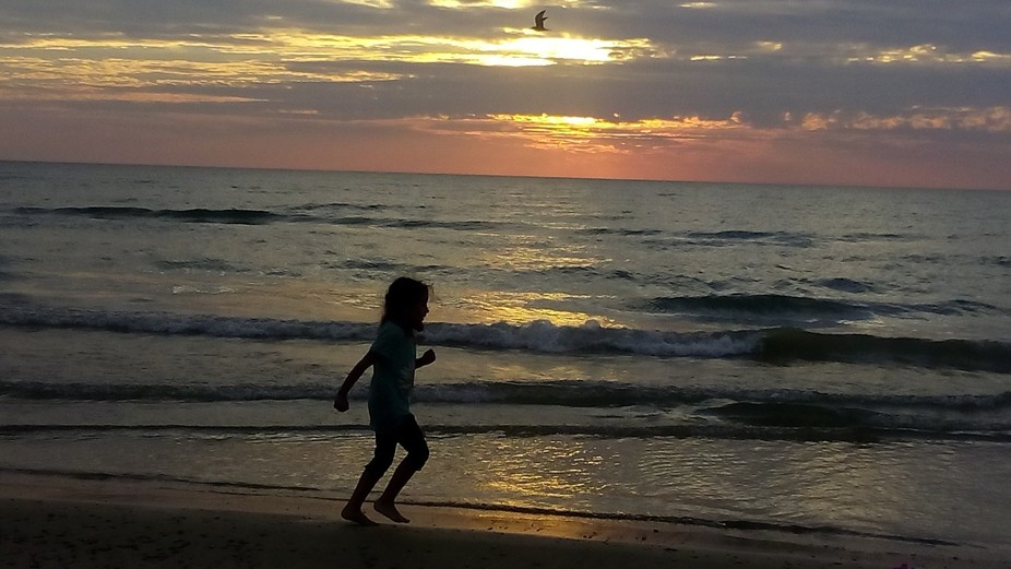 Running along the water at sunset.
