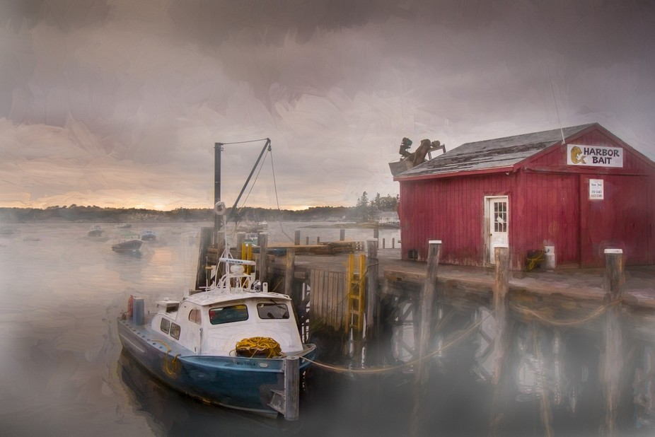Walking along the harbor edge at Booth Bay Maine one foggy morn I came upon this fishing boat doc...