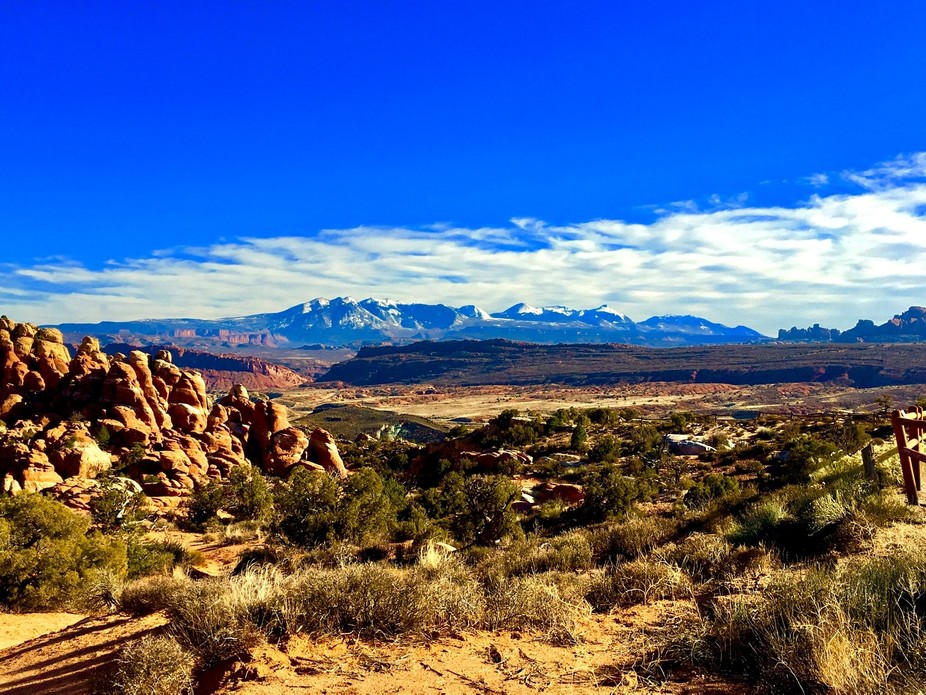 Taken from Arches National Park in the distance is the La Sall Mountain range in Utah!