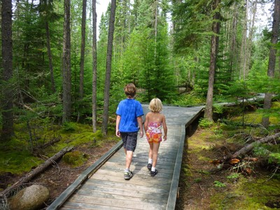 Boy and Girl walking through a forest