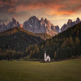 A small church in between the beautiful landscape of the Dolomites.