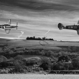 Mustang chasing Spitfire over the Sussex Downs, past the famous local landmark windmills Jack & Jill.  A photoshop composite of three images.