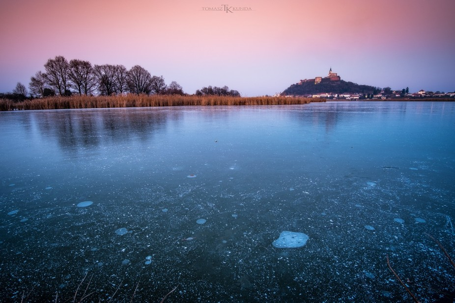 Frozen Lake and in the background Castle of Güssing in Austria