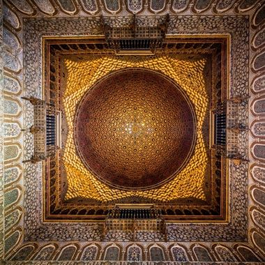"""The Alcázar of Seville (Spanish """"Reales Alcázares de Sevilla"""" or """"Royal Alcazars of Seville"""", is a royal palace in Seville, Spain, originally developed by Moorish Muslim kings. The palace is renowned as one of the most beautiful in Spain, being regarded as one of the most outstanding examples of mudéjar architecture found on the Iberian Peninsula. The upper levels of the Alcázar are still used by the royal family as the official Seville residence and are administered by the Patrimonio Nacional. It is the oldest royal palace still in use in Europe, and was registered in 1987 by UNESCO as a World Heritage Site, along with the Seville Cathedral and the General Archive of the Indies."""