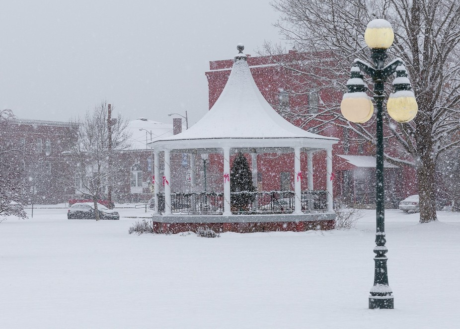 Light Snow falls in Lyndonville's Bandstand Park .