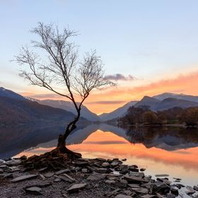 This photo was taken a few minutes after sunrise at Llyn Padarn Llanberis North Wales. I was going to have breakfast, but as soon as I saw the cl...