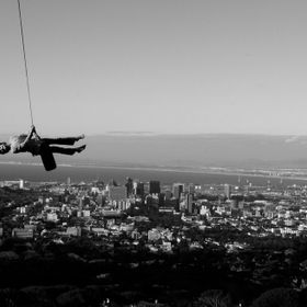 A picture I took when I was 12 years old of my sister flying over the beautiful city of Cape Town