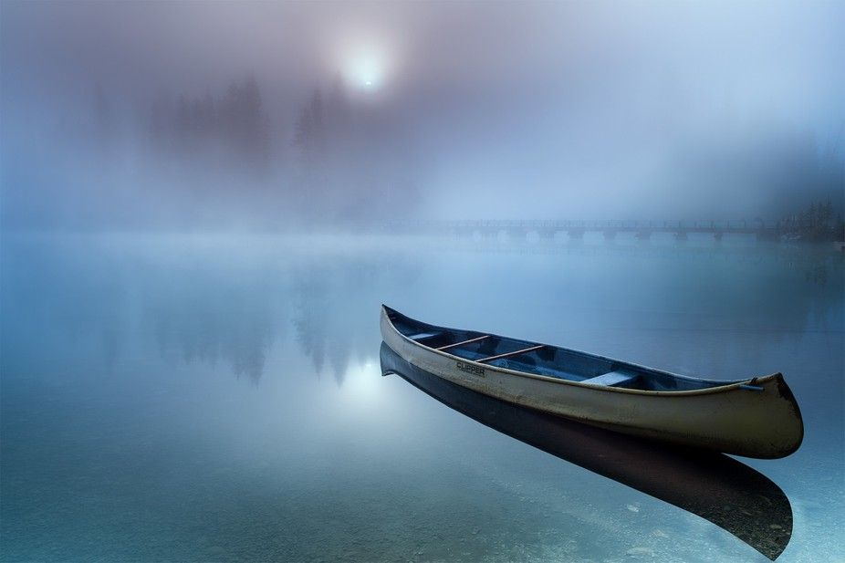 Emerald lake, BC, Canada at its best time - foggy fall morning. Quiet, peaceful, gorgeous moment,...