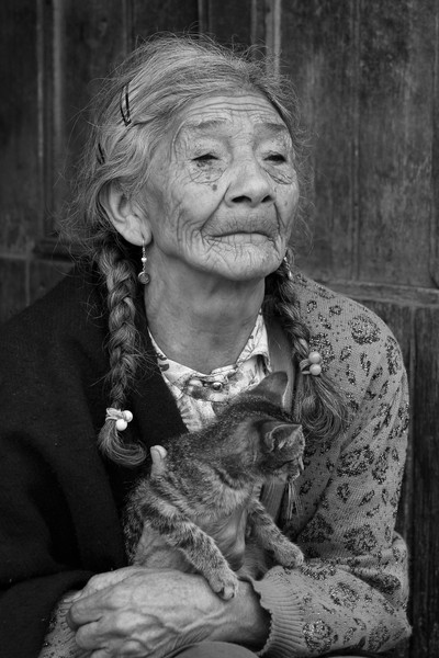 Poor Woman With a Cat