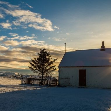 These pictures was taken in afternoon in south of Iceland. We are looking to west and the sun is going down-sunset. This is a old farm houses which could tell us lot of story.