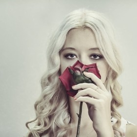 Vintage Style Portrait Of Young Beautiful Woman with rose