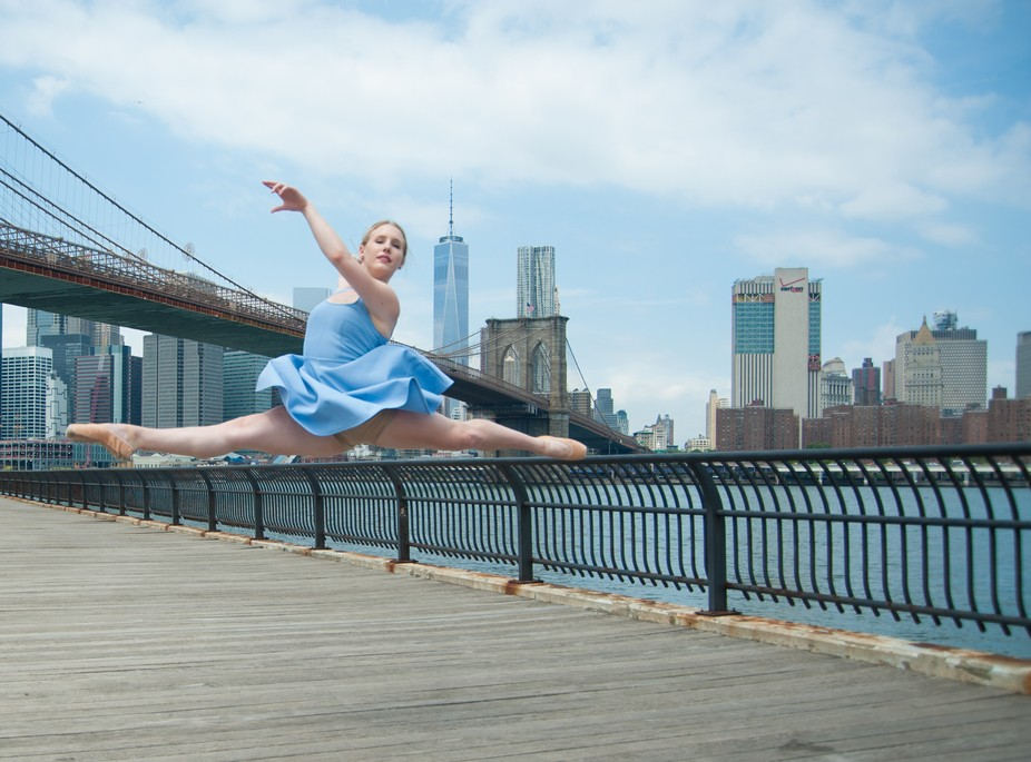 Dancer Hailey Stockbrugger Poses in Dumbo with Manhattan in the background.  Dancers In Public Sp...