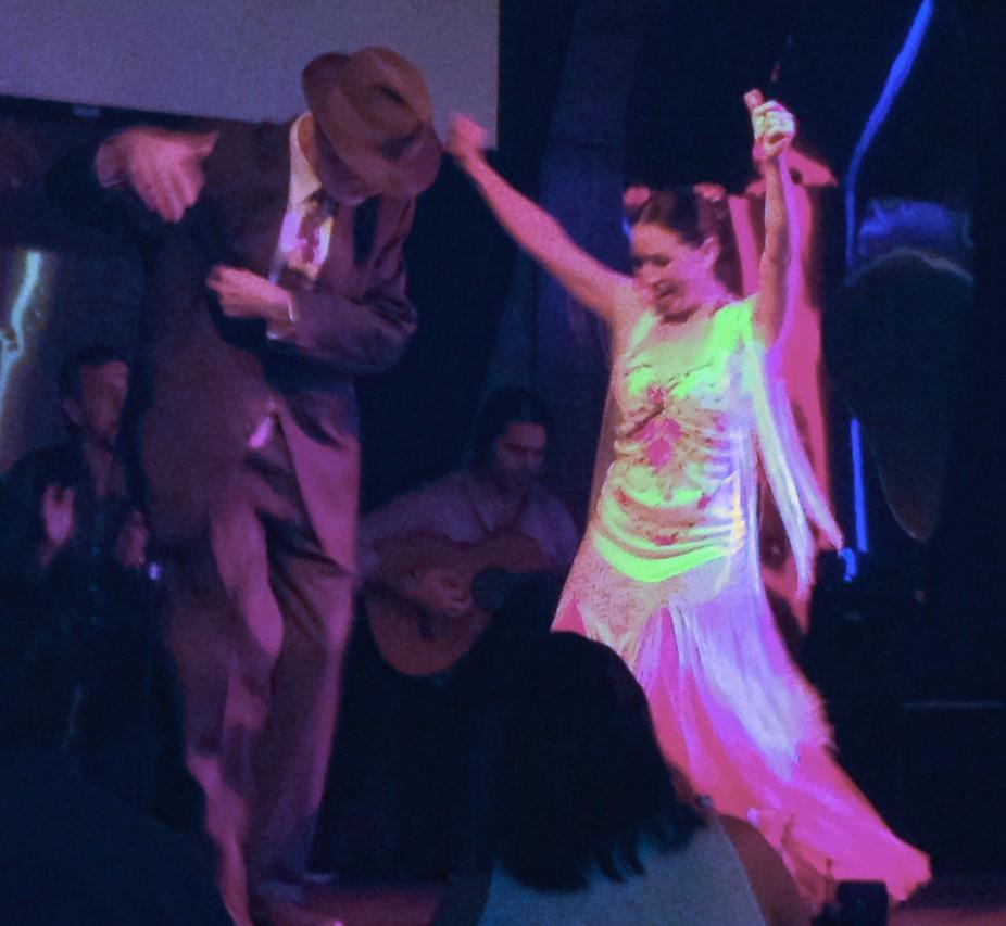 Gleeful flamenco dancers at a night club