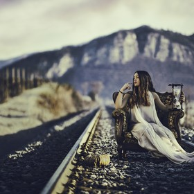 This is a conceptual shot over the theme of the passing of Time. The railway, the level passage is a place where we usually don't stop, stan...