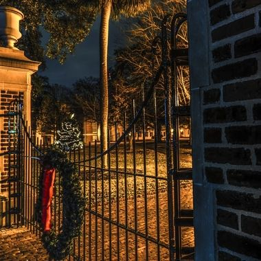 This is a Christmas wreath on one of the two gates to the Horseshoe in the middle of the campus of the University of South Carolina in Columbia, South Carolina.