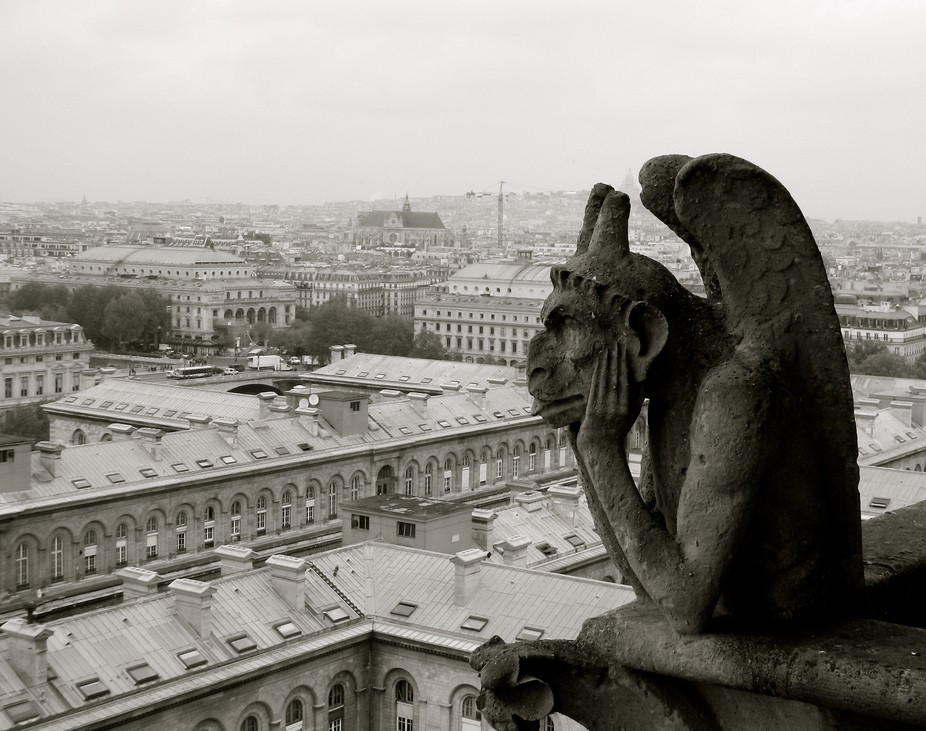 A gargoyle at Notre Dame Cathedral watches over the city of Paris.