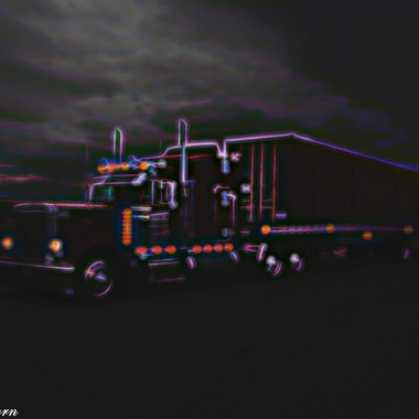 Husbands semi with a container, edited in FX Topaz Glow.