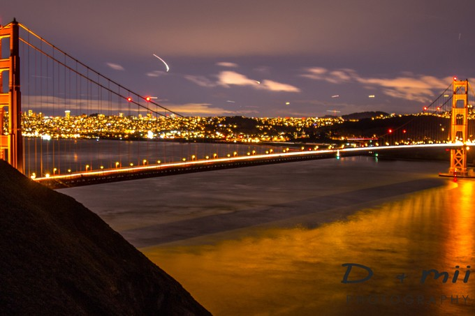 With a little light dance from the Airliners coming into SF International Airport.  Beautiful reflections from the mouth of the SF Bay as it passes under the Golden Gate Bridge.  A stream of light from the passing cars looks offers a unique view of action in a calm image