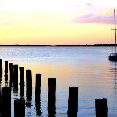 Sailboat parked off the shore of the park in Dunedin, FL at sunset last night.