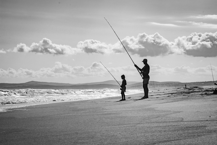 Walking up the beach near Great Brak River in South Africa, I came upon this father and son scene...