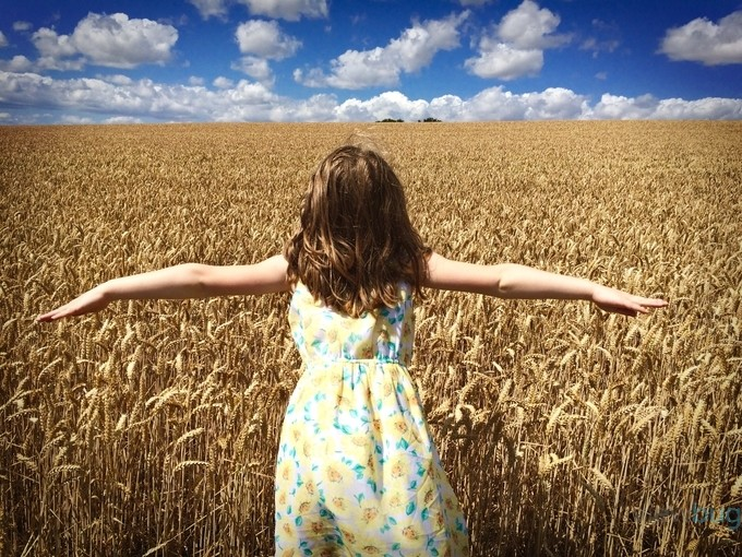 Girl in Field by howeyt - Children In Nature Photo Contest