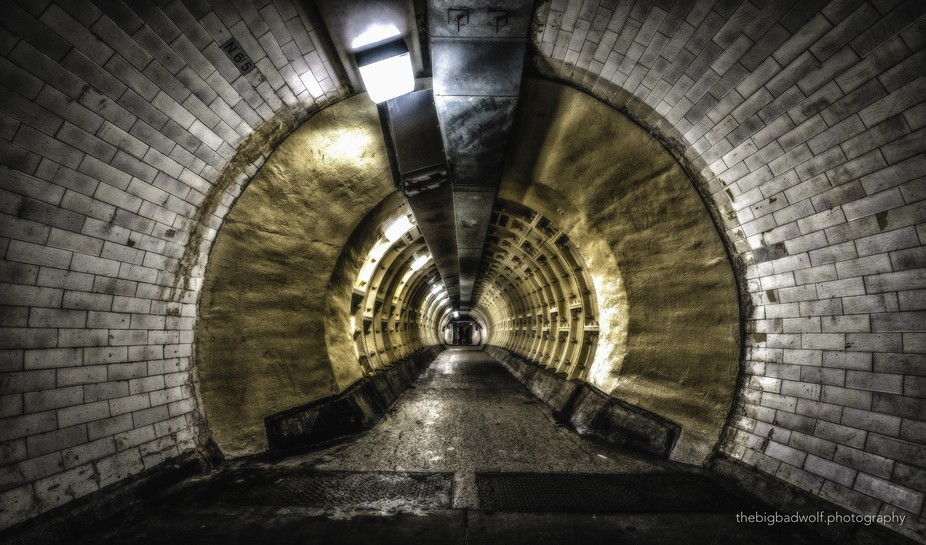 Two shadowy figures in the Greenwich foot tunnel. Are they eerie spirits in a tunnel that feature...