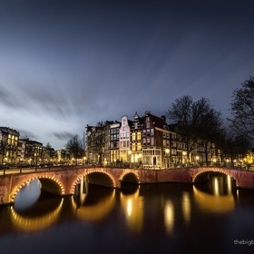 One of Amsterdam's iconic views, the intersection of the Kaisergracht and Leidsegracht canals. Kaizergracht (the Emperor's Canal) is the m...