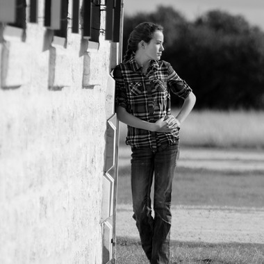 This is my oldest daughter, middle child.  I had taken some family pictures for a friend, and decided to do an impromptu shoot with my girls.  I looked up to see my daughter looking at something and was able to snap this picture.  This was taken at The Rock Church outside of Cranfills Gap, TX.