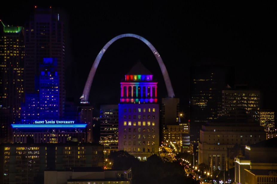The Saint Louis Civil Courts building lit up for the Pride Celebrations and framed in the Gateway...