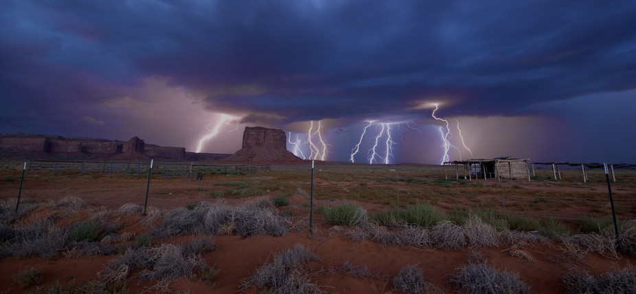 A stack of lightning strikes at Monument Valley during a rare monsoon storm.