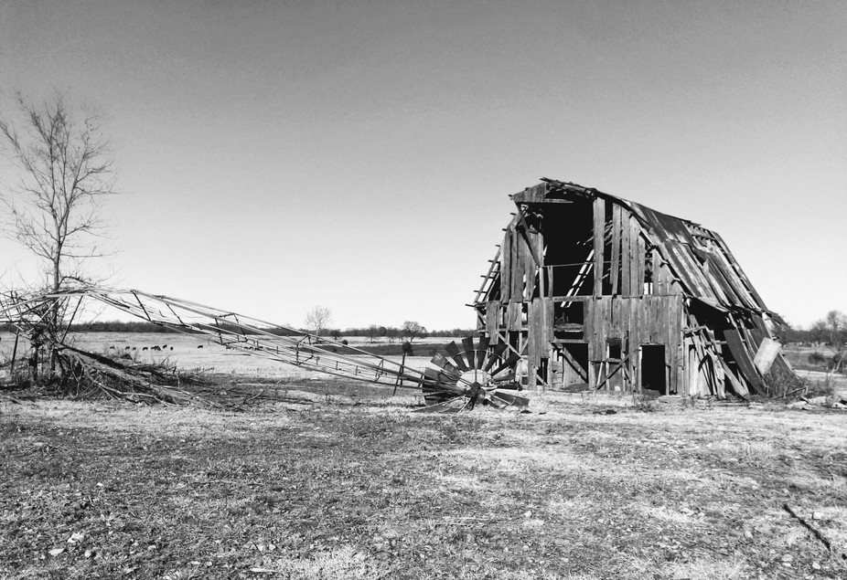 Here is a picture of the aftermath of a tornado. The barn took it on, but as you can see the wind...
